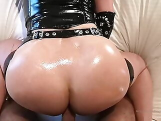 Redhead with big tits in latex gives blowjob & gets fucked blowjob anal